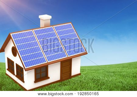 Digitally generated image of 3d house with solar panels against green field under blue sky