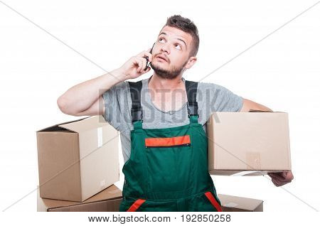 Mover Guy Holding Cardboard Box Talking At Phone