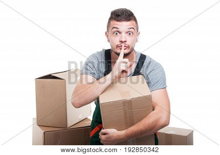 Mover Guy Holding Cardboard Box Making Silence Gesture