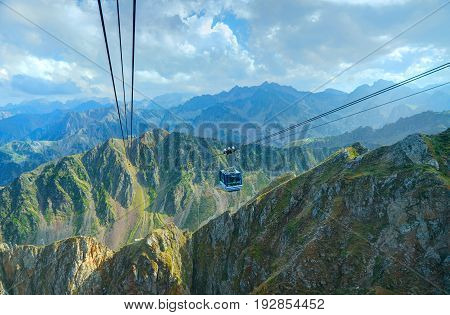 FRANCE SEP 29 2011: View on cable-way cabin funicular to Pyrennes mountains ski station observatoire Pic du Midi peak. Green mountains. France holidays vacations famous best tours trip travels