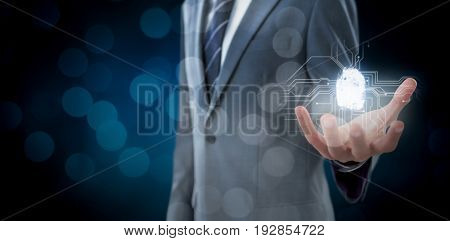 Midsection of businessman indicating against glowing background