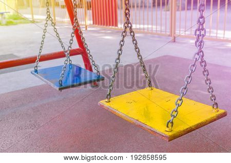 Empty chain swing in playground close up