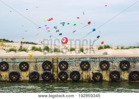 Colorful Kites on Baltic Beach in Leba, Poland.