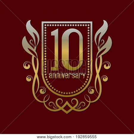 Tenth anniversary vintage logo symbol. Golden emblem with numbers on shield in wreath.