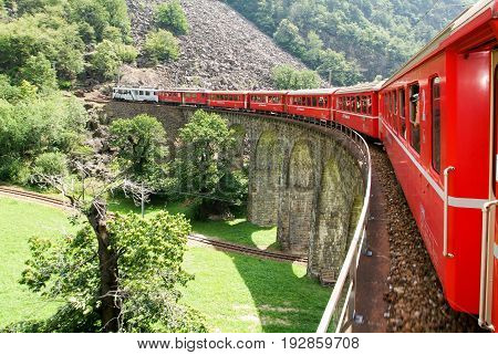Bernina Express Train At Brusio On The Swiss Alps