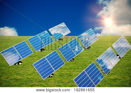 Graphic image of 3D blue solar panel arranged in rows against scenic view of blue sky