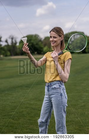 Young Casual Woman Holding Badminton Racket And Shuttlecock At Park