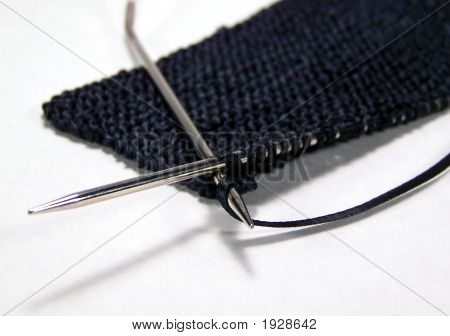 Knitting Black Ribbon With Silver Needles