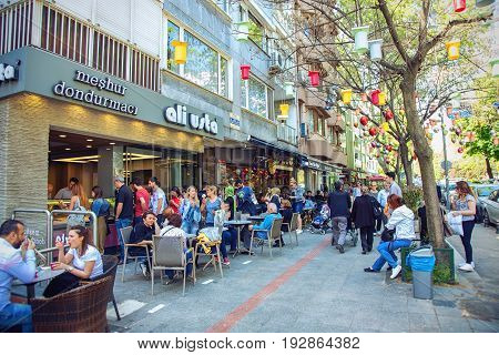ISTANBUL TURKEY - MAY 3 2017: Famous street cafe of ice cream in Kadikoy district and a lot of people arownd