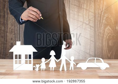 underwriter drawing a family against wood panelling