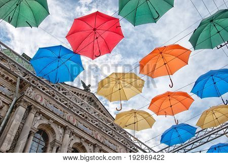 SAINT - PETERSBURG, RUSSIA - JUNE 26, 2017: Alley of soaring umbrellas, city installation in Solyany (Salty) Lane. On the left is Museum of Applied Art School of Art and Design after A.L. Stieglitz