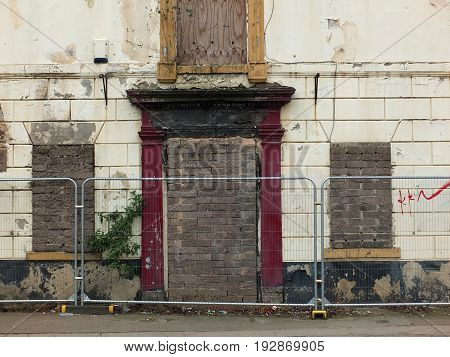 dereluct abandoned house on the street with barriers in wakefield yorkshire englend