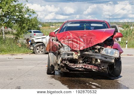 Road Accident On A Country Road Between The Crossover And The Red Sedan