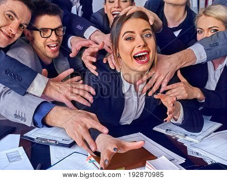 Business people office. Mad team people are unhappy with their leader. Office workers seek attention of their superiors. Intern manager does not cope with his duties. Crowd in stress.