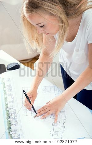 Blonde Architect Is Making Amendments In Her Project