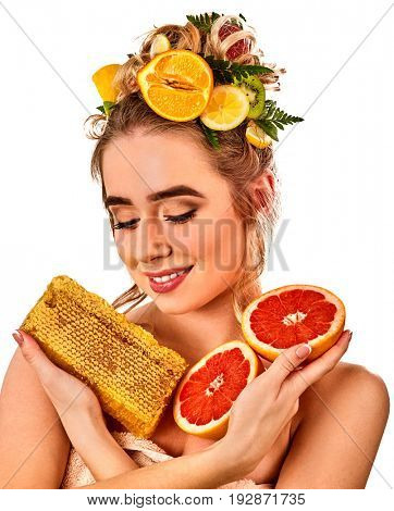 Facial honey mask for woman lips. Honeycombs natural homemade organic threatment. Skincare by face and health concept on isolated. Medical concept. Natural ingredients to create cosmetics.