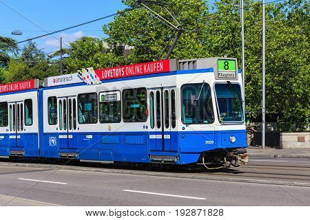 Zurich, Switzerland - 18 June, 2017: a tram passing along General Guisan quay in the city of Zurich. Trams make an important contribution to public transport of the city, they have been a consistent part of Zurich's cityscape since the 1880s.