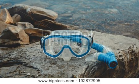 Mask For Freediver And Snorkel Lie On The Beach On The Rocks. Tourism And Travel Concept