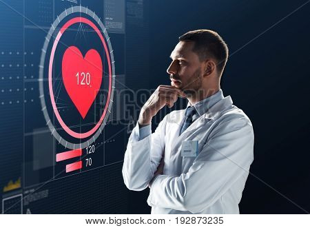 medicine, cardiology and healthcare concept - male doctor or scientist in white coat looking at heart rate projection on virtual screen over black background