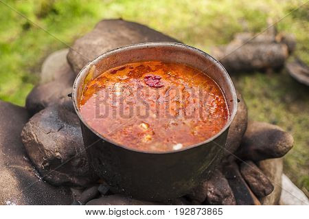 A pot of food at the stake on fire