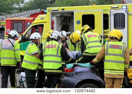 Beaulieu, Hampshire, Uk - May 29 2017: Firemen And Paramedics Removing The Casualty From A Car With