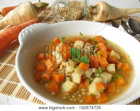 Vegetable soup with carrots, root parsley and buckwheat