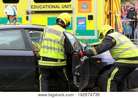 Beaulieu, Hampshire, Uk - May 29 2017: Firemen Gaining Access To A Car During A Vehicle Rescue Demon