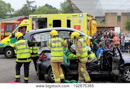Beaulieu, Hampshire, Uk - May 29 2017: Firemen Removing The Roof From A Car During A Vehicle Rescue