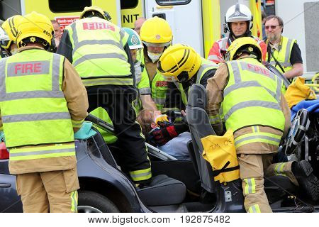 Beaulieu, Hampshire, Uk - May 29 2017: Firemen And Paramedics Preparing To Remove The Casualty From