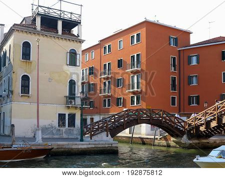 20.06.2017, Venice, Italy: Canal With Boats And Colorful Facades Of Medieval Houses