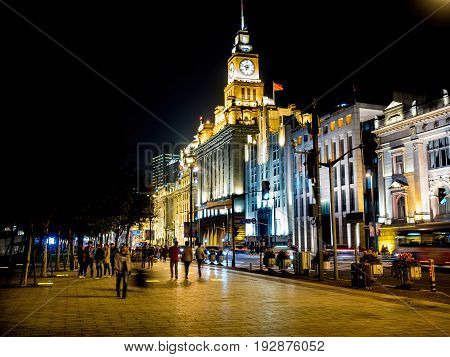 Shanghai, China - Nov 4, 2016: Night view along The Bund, featuring buildings on Zhongshan East 2nd Road in various architectural styles. Area is popular with local and foreign visitors.