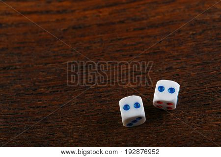 Rolling Two Dice On A Wooden Desk. Gambling Dices Falling. Dices Set To Play Backgammon. Back Gammon