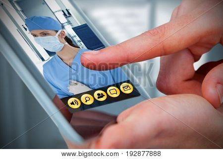 Hands using tablet on white background against wheelchair in the corridor