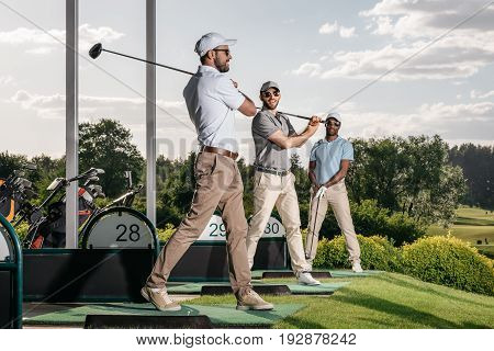 Group Of Golf Players Playing Golf Together At Golf Course