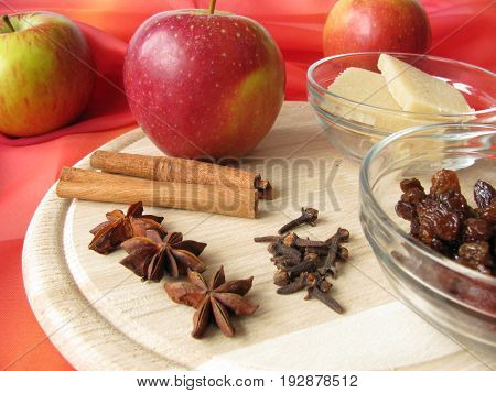 Ingredients for homemade baked apple, spices, marzipan an rum raisins