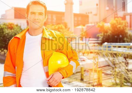 Portrait of male architect wearing reflective workwear at construction site