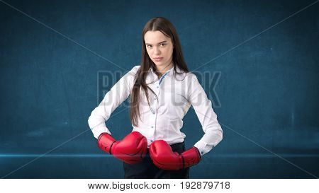 Young Beautiful Woman Dress In White Shirt Standing In Combat Pose With Red Boxing Gloves. Business