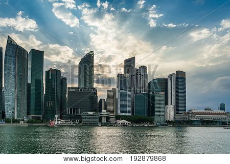 Singapore Cityscape Financial Building With Dramatic Cloud In Marina Bay