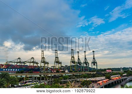 Singapore - May 27 2017: Keppel Harbour Port of Singapore background dusk View of Warehouse Port in evening time and Skytrain to Sentosa