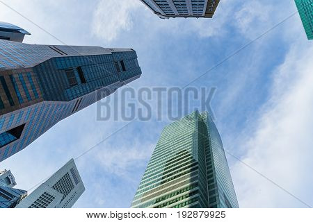 Bottom View Of Modern Skyscrapers In Business District Against Sky