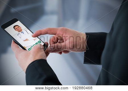 Businessman using smart phone against empty bed in the hospital room