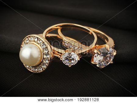 jewelry rings with diamond on black cloth