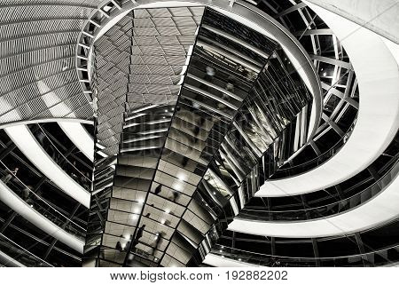 BERLIN, SEP,19, 2006: View on modern Reichstag dome interior made of glass and constructed as swirl with spiral footwalk on top of rebuilt Reichstag building. Famous Berlin architecture