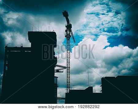 Construction site with cranes Industrial structure on sky background.
