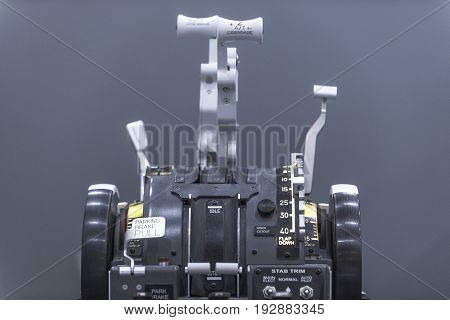 Aircraft cockpit. Classical pedestal with controls. Closeup. Isolated on gray