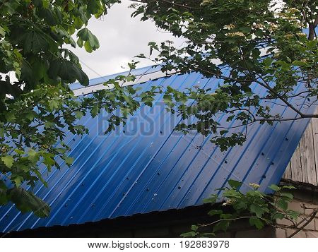 Garden lodge roofed by blue metal sheets