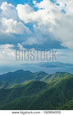 View of blue sky sea and mountain seen from Cable Car viewpoint, Langkawi, Malaysia. Picturesque landscape with tropical forest beaches small Islands in waters of Strait of Malacca