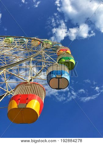 Bottom view of colorful ferris wheel with a beautiful blue sky at Luna park Sydney Australia.