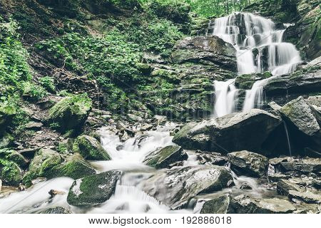 waterfal in deep forest of Carpathian mountains