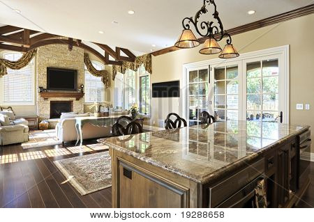 Large kitchen with view into adjoining rooms
